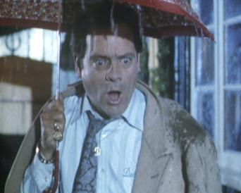 Del under an umbrella in Friday the 14th Only Fools and Horses